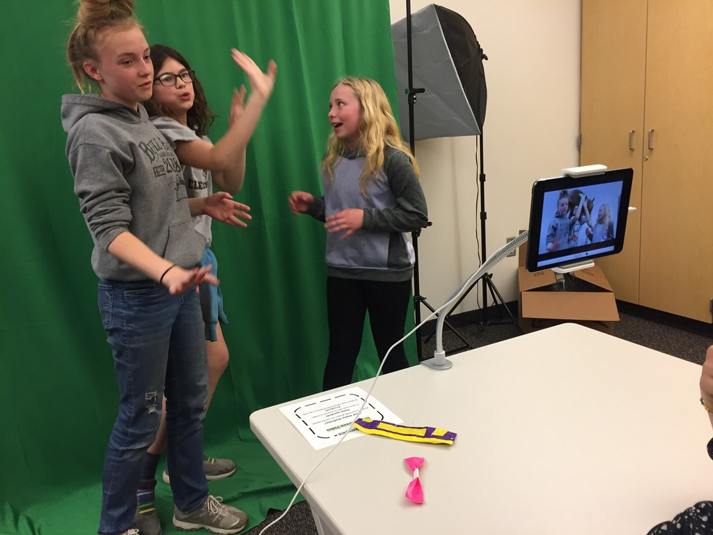 "Using a green screen to create videos in ""other worlds"" & ""report the news"""