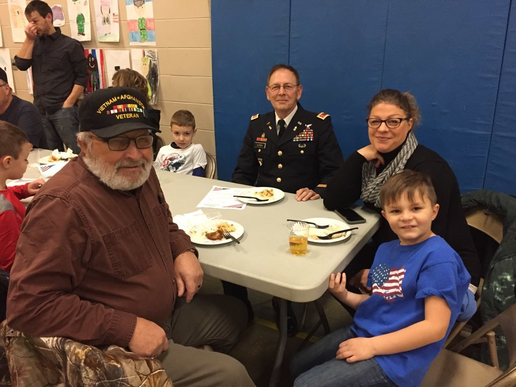 Veterans share a special breakfast with students at the elementary school.