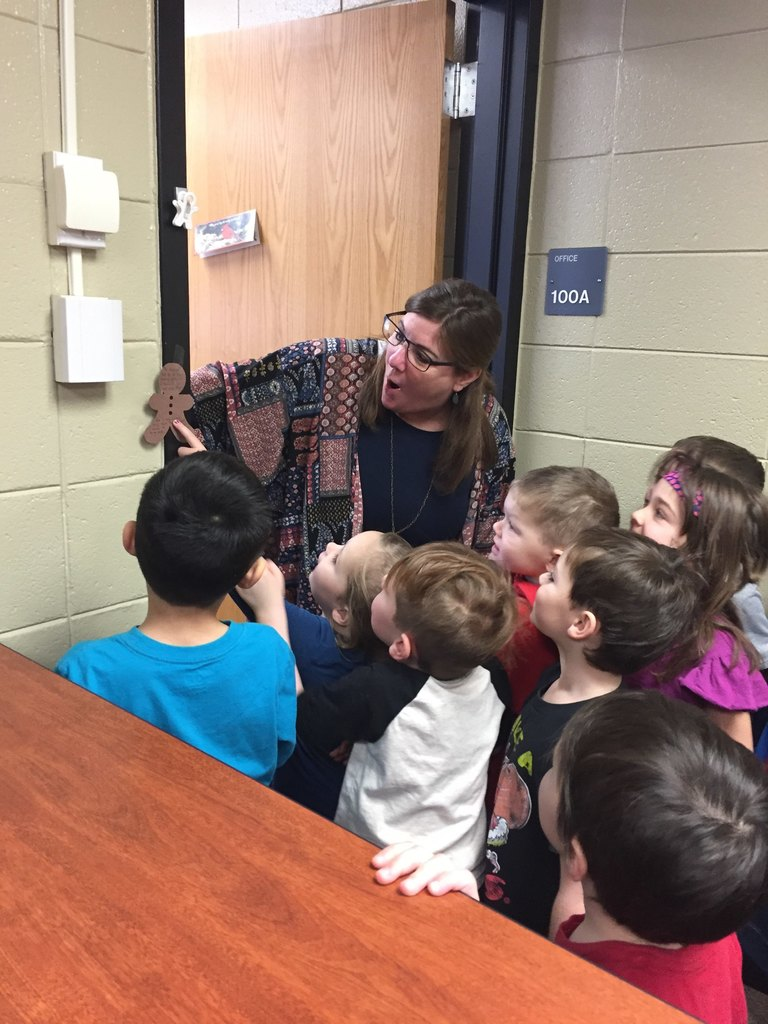 Principal Kathy enjoys the excitement of the Kindergarten search for the Gingerbread Man