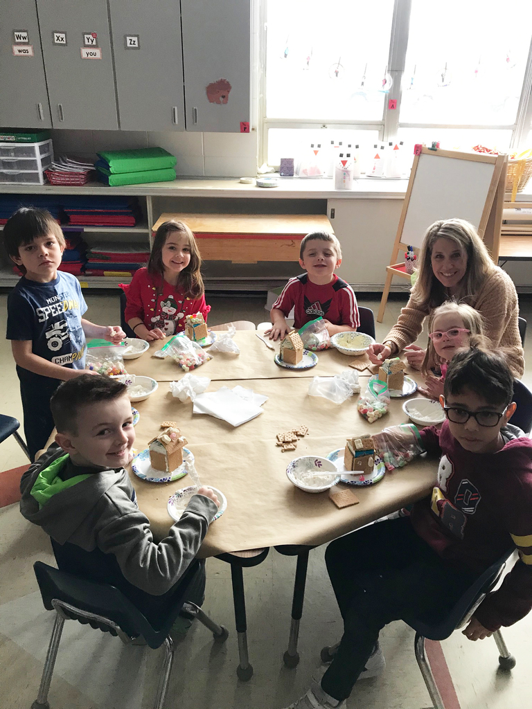 Mrs. Martin's class making gingerbread houses