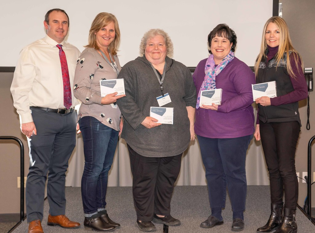 Shane Tappe, Laurie Paskewitz, Jody Johnson, Natalie Johnson and Jennifer Pantzke received awards for LLA participation from Sourcewell