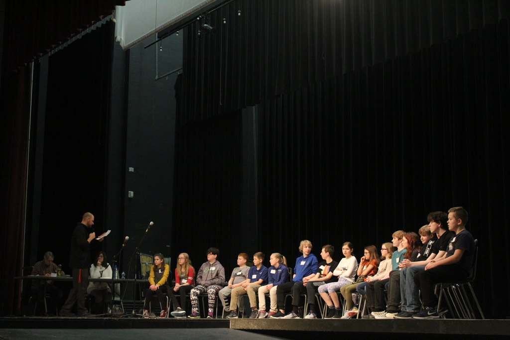 Principal Regan explains the spelling bee format